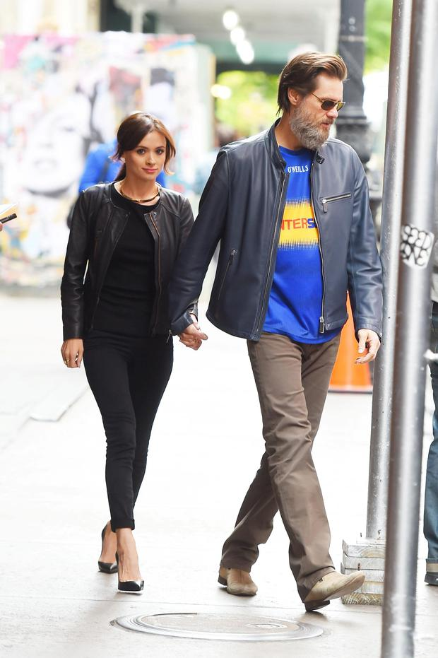 Jim Carrey and his former girlfriend, Cathriona White, hold hands while taking a walk in Manhattan in 2012