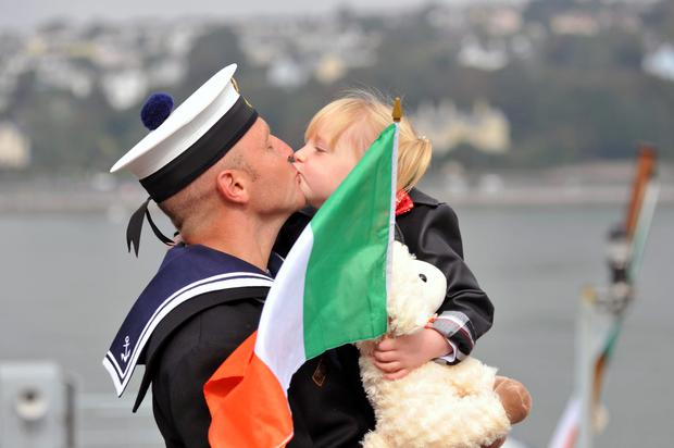 Leading Seaman Darren Buckley is welcomed home by daughter Bella Nora Lee (4)