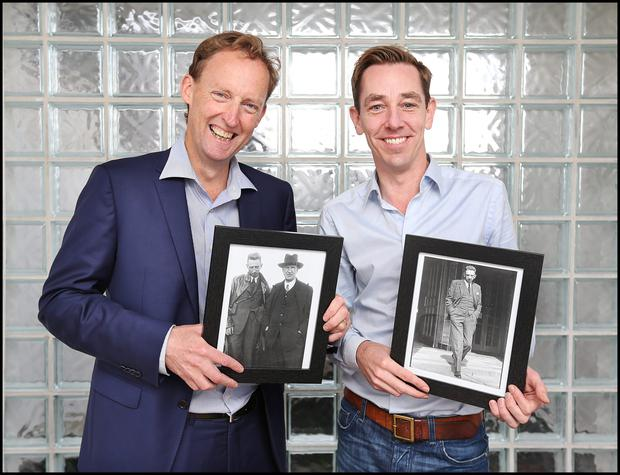 Barry Andrews and Ryan Tubridy hold a photograph of their Grandfather Todd