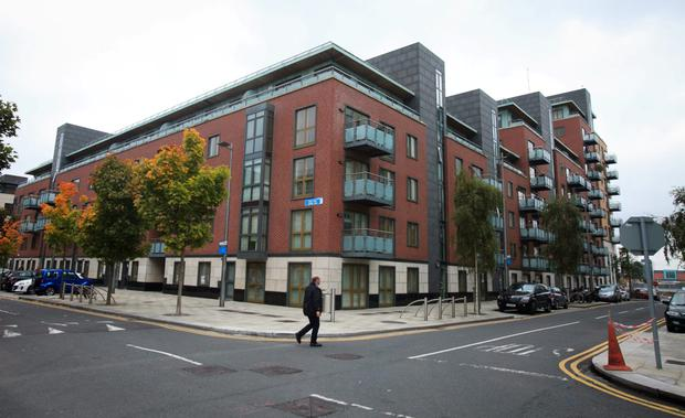 Minister Alan Kelly believes property taxes may be able to pay for repairs at the Longboat Quay apartments