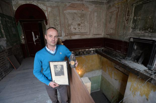 Charles Duggan Heritage Officer at Dublin City Council with artefacts inside the Tenement Musuem on Henrietta Street Dublin which should be open 2017. Pic: Justin Farrelly.