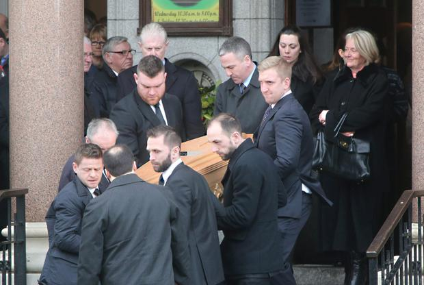 The coffin of Cathal Sweeney carried by pall barers