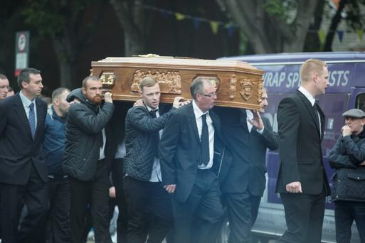 Mourners carry the coffin of murdered Gary Hutch outside the church yesterday
