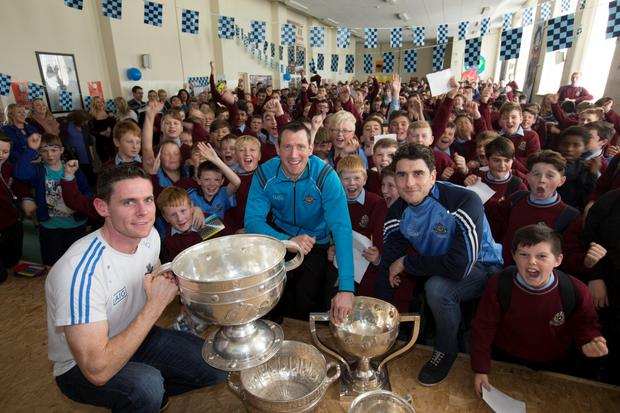 Stephen Cluxton, Denis Bastick and Bernard Brogan with pupils