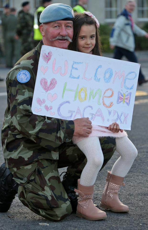 Noel O'Callaghan from Mullingar is welcomed home by his grand daughter, Aleesha Penrose (6)pictured this evening when 103 Irish troops from the 48th Infantry Group, United Nations Disengagement Observer Force (UNDOF) returned home to Casement Aerodrome, Ba