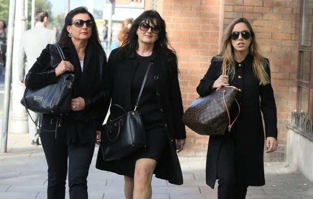 Michelle Rocca (right), Van Morrison's wife, leaving the court with her sister Laura