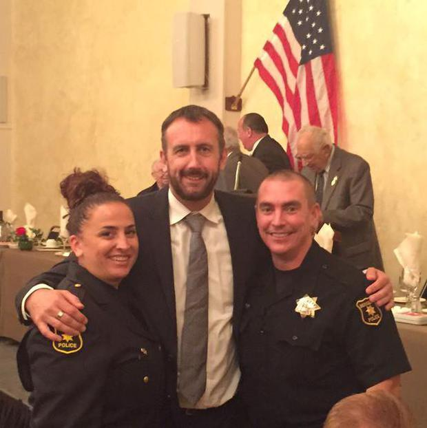 Consul General Philip Grant alongside Berkeley police officer Stephanie Polizziani and her Irish-American husband, officer Kevin Neff.