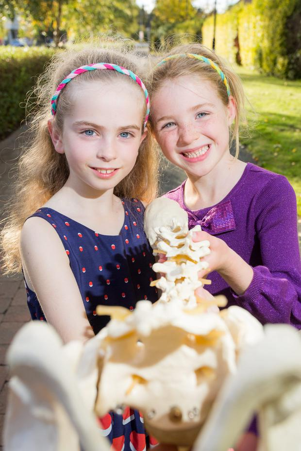 Picture shows from left Lara O'Connor (9) and Florence Ross (5) as the Chiropractic Association of Ireland (CAI) launched the seventh annual Straighten Up Ireland Week (12-18th October) to include World Spine Day on Friday 16th October. The theme of 'Healthy Spine, Healthy Brain' aims to highlight the importance of a strong, flexible and balanced spine to keep brains healthy and enhance overall body function and quality of life