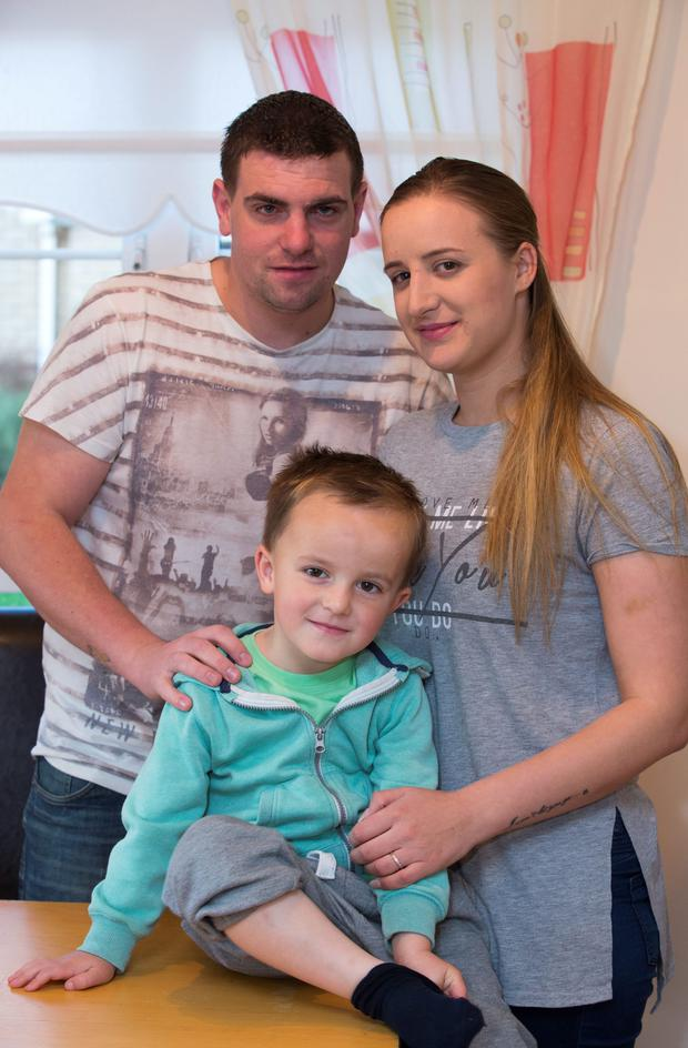 BUDGET SPL; Michael O'Donnell and his wife Mary Jane with their son Josh at their Tyrrellstown home last night.