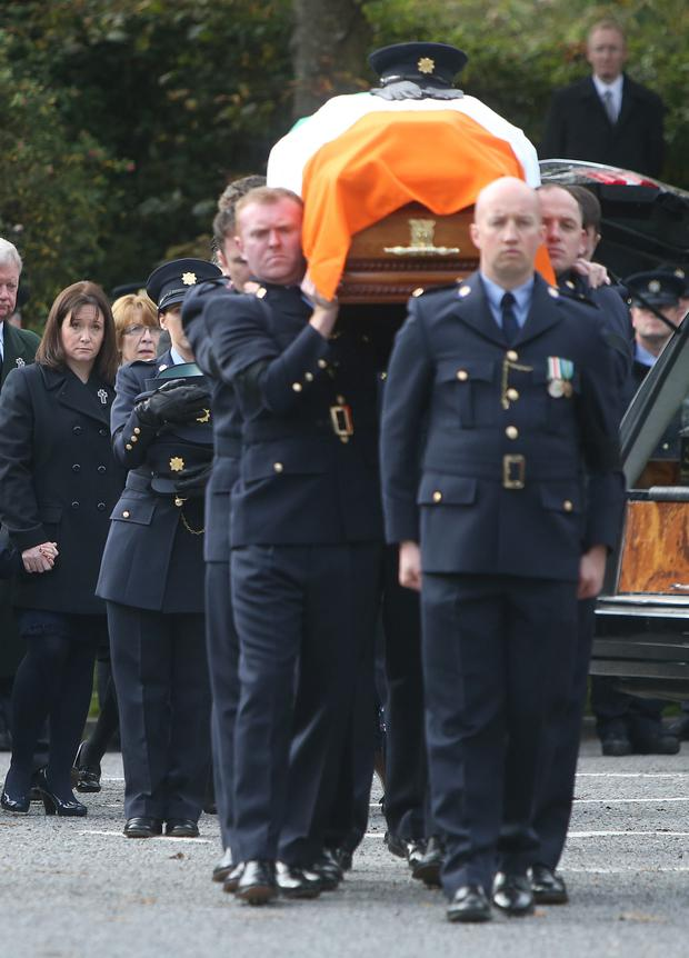 Mourners follow the remains of slain Garda Tony Golden as he made his final journey this week