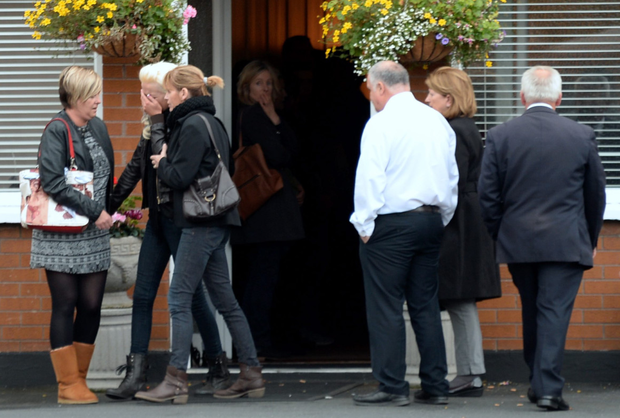 Mourners pay their respects at the removal in Bray