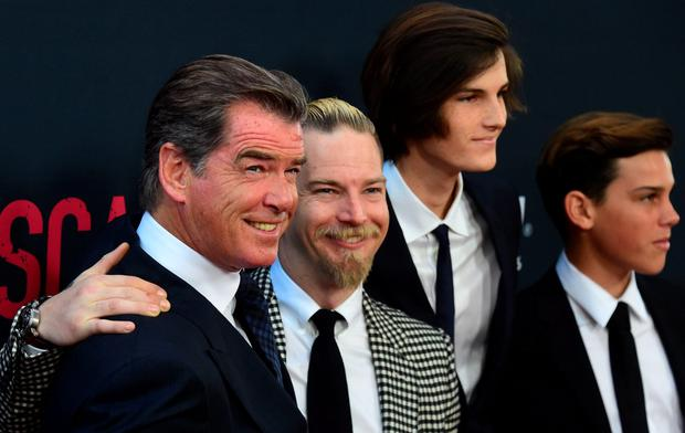 Cast member Pierce Brosnan poses with his three sons on arrival for the Los Angeles premiere of the film 'No Escape' in Los Angeles, California