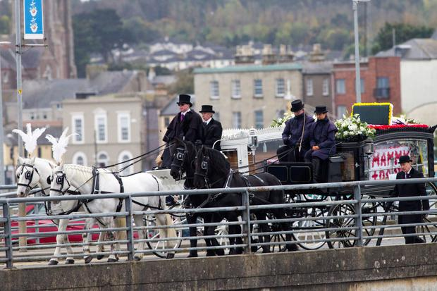 The remains of Sylvia and Thomas Connors and their three children, Jim, Christy and Baby Mary going through Wexford Town after their prayer service.