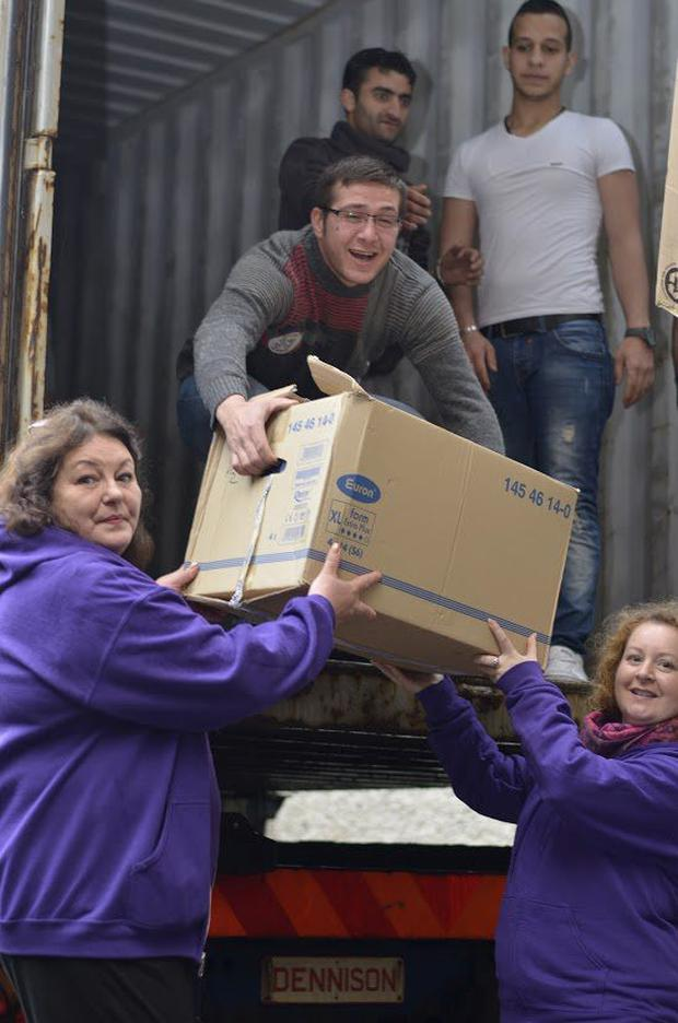 Fiona Duffy and Bridget Wright of Human Appeal loading a container with aid for Syria