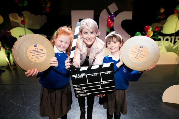 TV presenter Sinead Kennedy is pictured at the 11th FÍS Film Festival presenting Orla O'Hara and Lucy Robinson, students from Redeemer Girls NS, with the 'Aileen MacKeogh Overall Winners Award 2015' for their film The Jelly That Wouldn't Wobble
