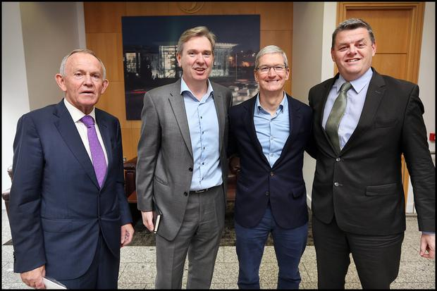 Leslie Buckley, Chairman of INM; Stephen Rae, Group Editor in Chief at INM; Tim Cook, Apple CEO; and Robert Pitt, CEO of INM, during Mr Cook's visit to INM's offices in Dublin