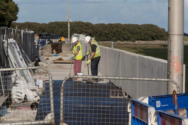 Construction work on the Clontarf flood defence wall has been halted