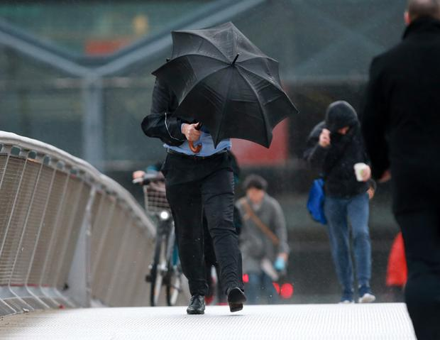 A man struggles with his brolly on Dublin's Sean O'Casey Bridge