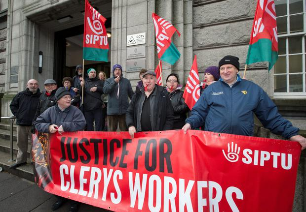 Clerys workers take their protest to Kildare Street, demanding changes in the law