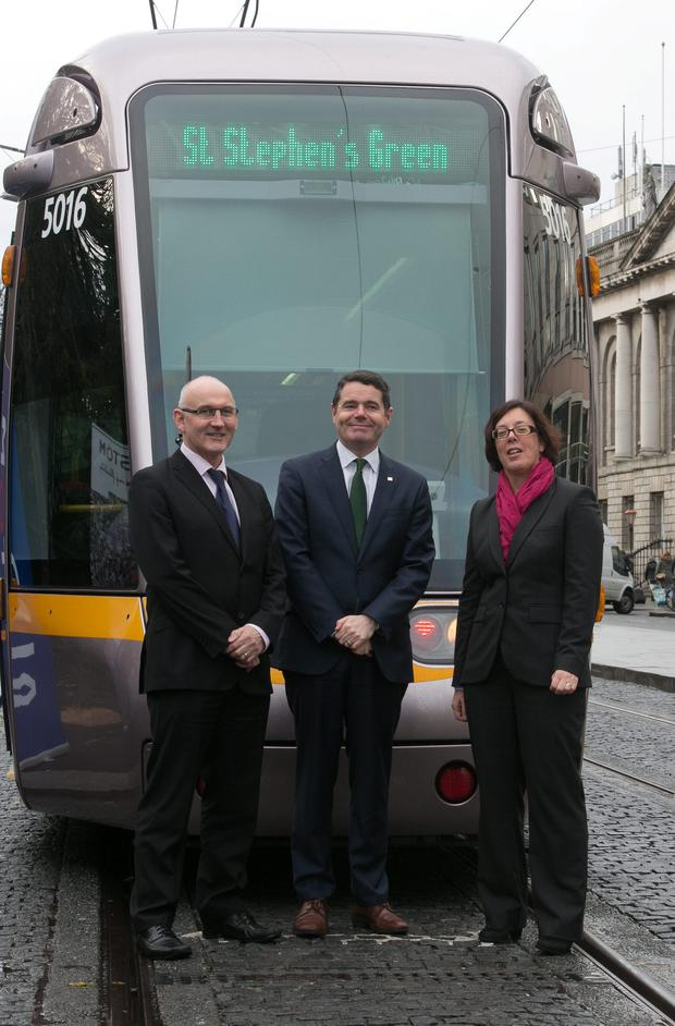 Michael Nolan of Transport Infrastructure Ireland, Transport Minister Paschal Donohoe, and Anne Graham of the NTA