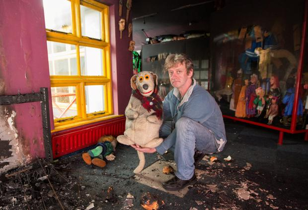 Liam Lambert with kids' favourite, Judge, after the blaze