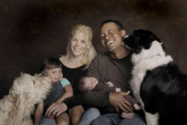 Tiger Woods, Elin Woods...In this photo provided by the Tiger Woods family,Sam, Elin, Tiger, Charlie Woods, from left, and their dogs Yogi, left, and Taz pose for a family photo Tuesday, Feb. 17, 2009, in Orlando, Fla. Charlie Woods was born on February 8