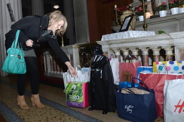 Gifts, including a model of Darth Vader, being left at the altar in the Pro-Cathedral
