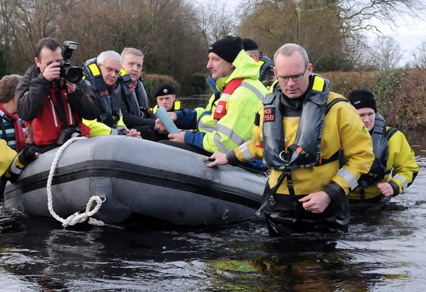 Minister Simon Coveney wades through the flood waters in Springfield, Clara Photo: Gareth Williams / Press 22
