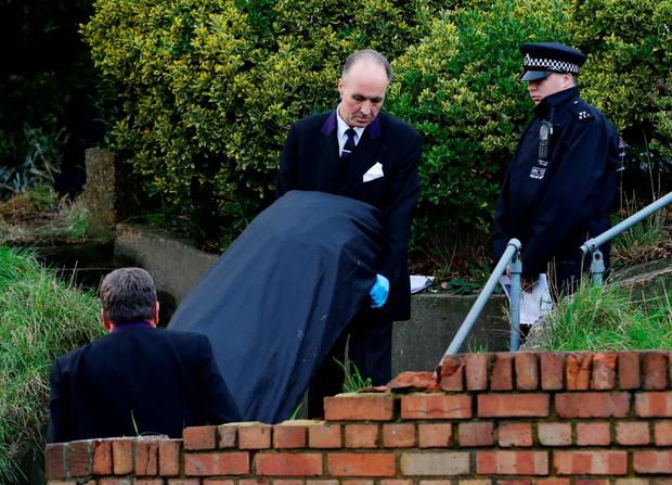 Police remove remains from the scene