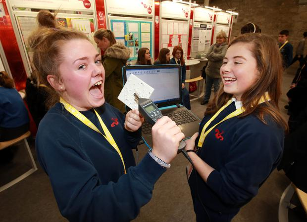 Naoise Tobin and Heather Murphy, from Sutton Park School, Dublin, test out their sound absorbing paint at the BT Young Scientist exhibition