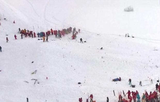 Rescue teams gather at the avalanche site in the Les Deux Alpes resort in France