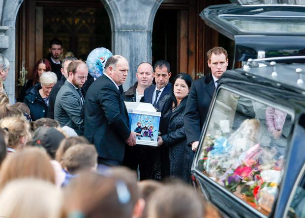Family members carry the coffin of Alexandra Costa-Burke at her funeral at Kilmallock Church in Limerick