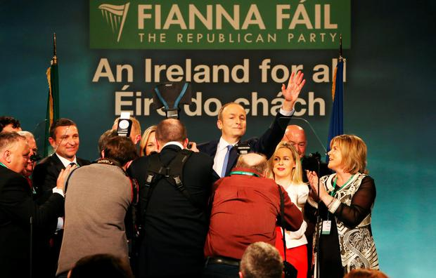 Fianna Fail leader Micheal Martin waves to supporters. Photo: PA