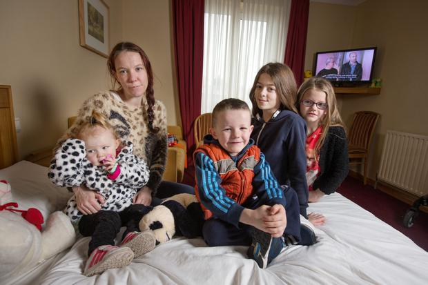 Antoinette Geoghegan, who is living in a hotel room with with her children Daisy, Chloe, Holly, and Sean after their home was damaged by a fire.