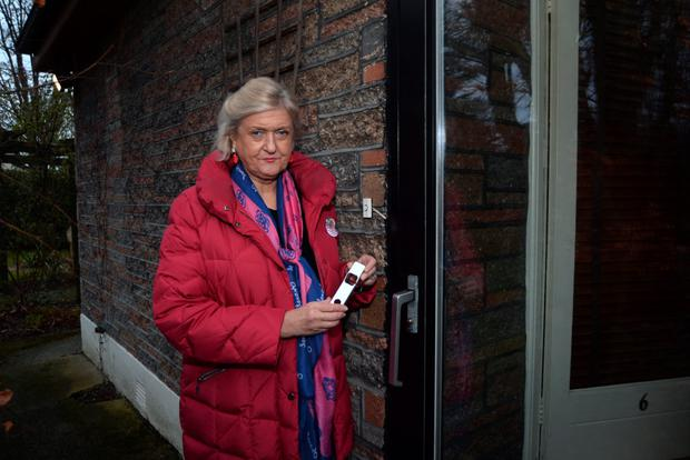 Senator Mary White shows damage caused to her door