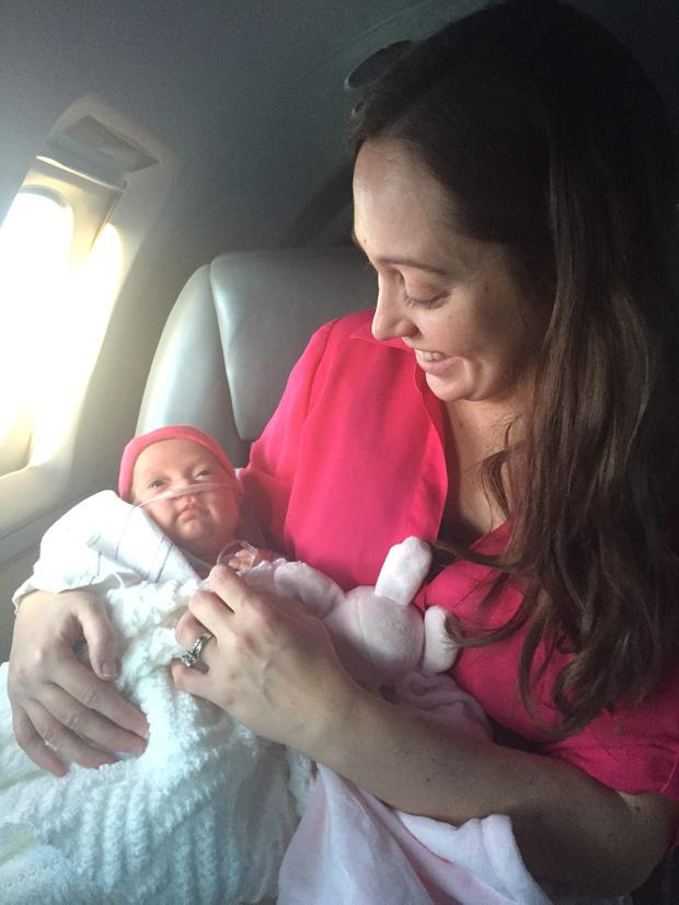 Jenny Drake and baby Zoe on the flight back to the US