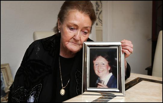 Mary Anne Forrester with a photograph of her late sister Ellen (INM)