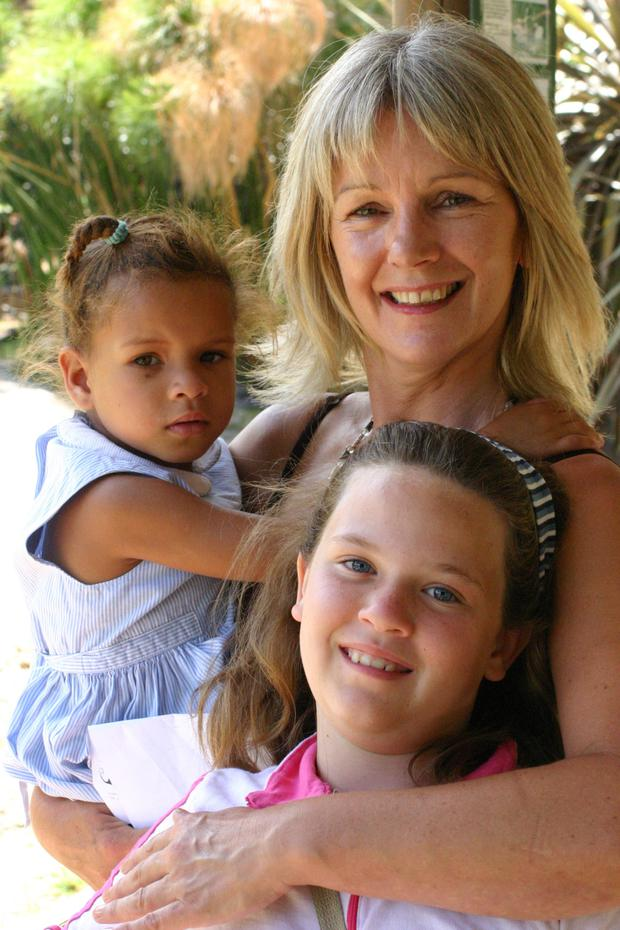 Sheila Geraghty with two girls she met while volunteering in South Africa