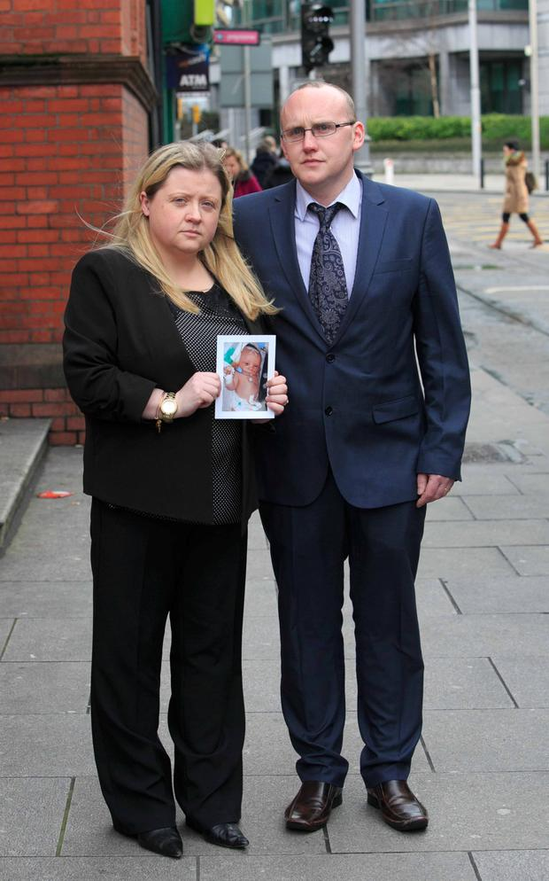 Maree Butler and Eoin Byrne hold a photo of their baby, Darragh who died five days after he was born. Photo: gareth chaney Collins