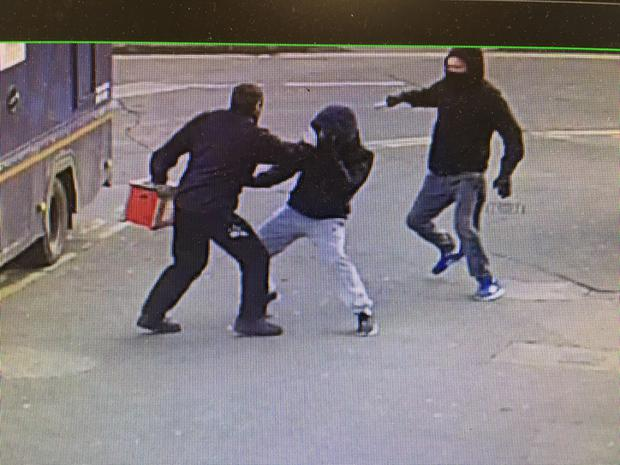 CCTV images of the vicious knife robbery of a security man at the An Post office in Bluebell