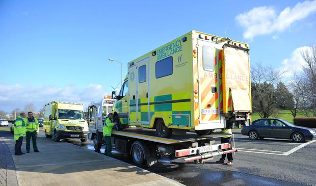 A broken-down ambulance sits on a recovery truck (Ciara Wilkinson)