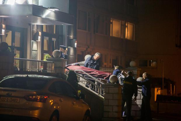 The body of David Byrne is removed from the Regency Hotel