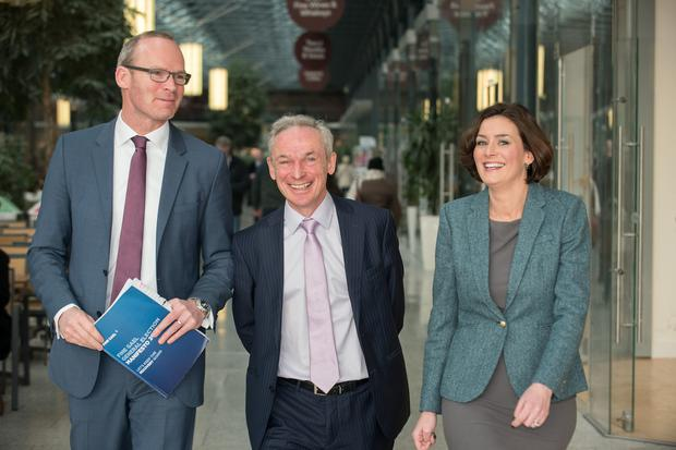 Minister Simon Coveney at a Fine Gael campaign event yesterday with Richard Bruton and election hopeful Kate O'Connell (Barry Cronin)