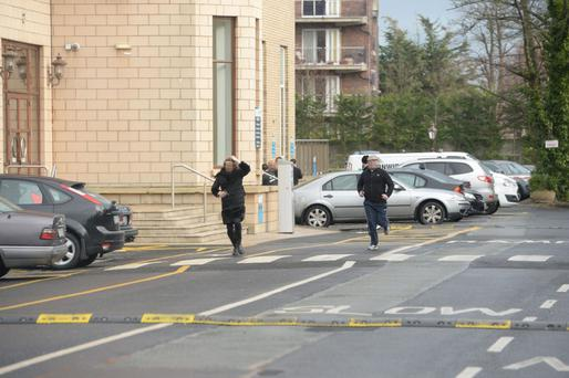 The 'flatcap' gunman and his accomplice flee the murder scene at the Regency in Drumcondra