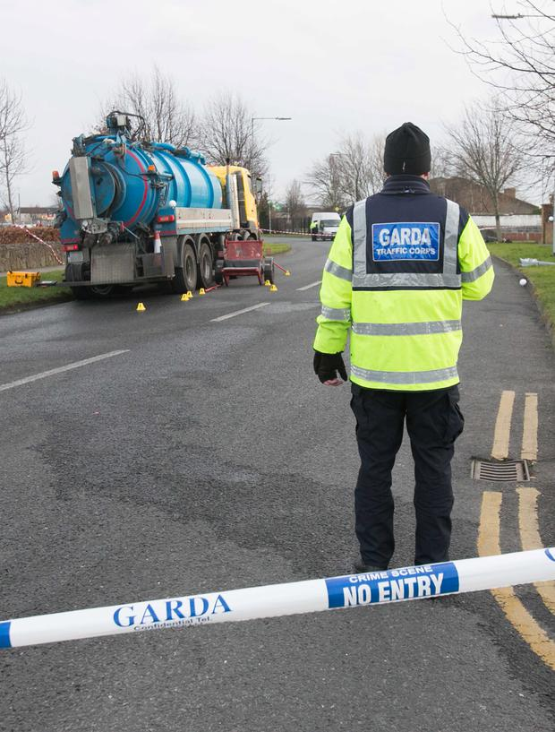 A garda at the scene of the fatal collision in which Sean Doyle was killed (Collins)