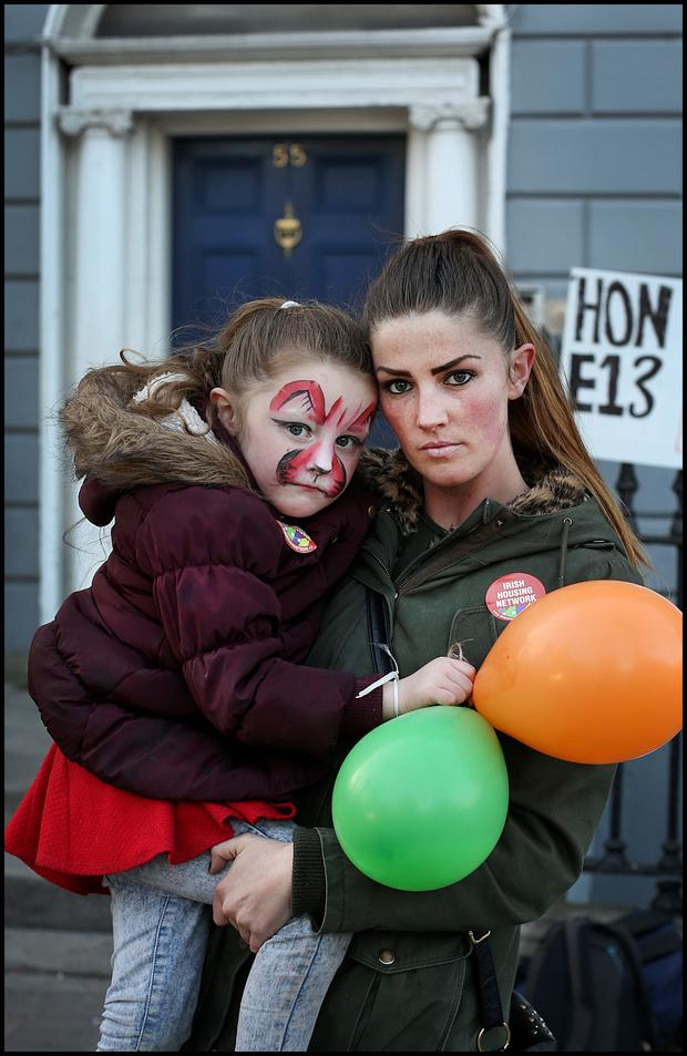 Rachel McGuinness and her daughter at the protest