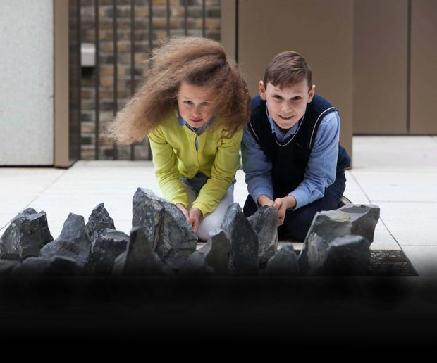 Alex Asanov (10) from Swords, with his sister Ava (8), and some of the 40 stones at the GPO Witness History visitor centre (Photocall Ireland)
