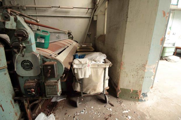 An industrial washing machine and a laundry basket at the Donnybrook site