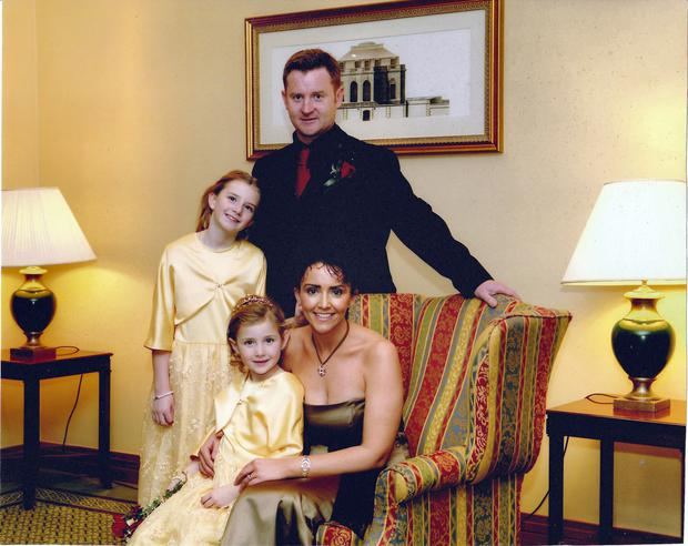 Marina Jordan Killoran with husband Alan and daughters Shannon and Erin before she was affected by her illness