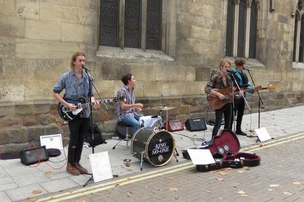 Buskers with amplifiers. (Photo posed by models)